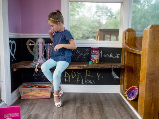 Avery Boyd, 5, plays dress-up on the second floor of