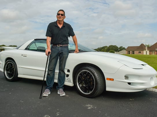 Jacques Doiron and his restored  98 Pontiac Trans Am.