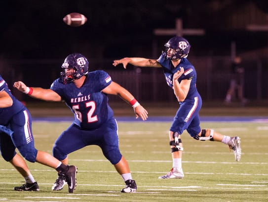 Rebels quarterback Wesley Blazek throws a pass as Teurlings