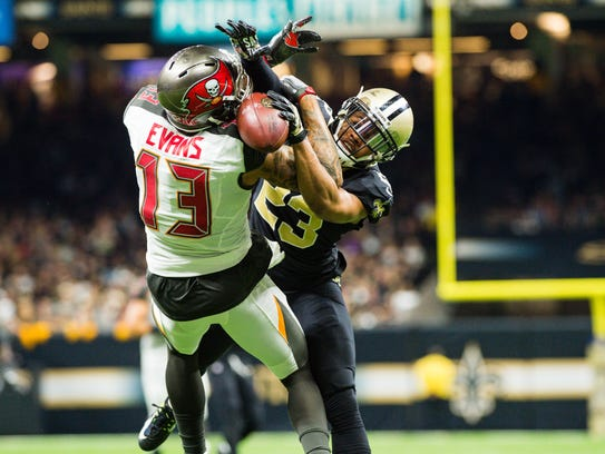 Saints cornerback Marshon Lattimore breaks up a touchdown