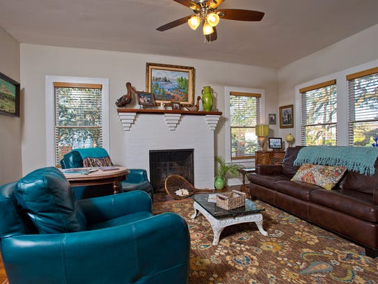 The cozy living space features hardwood flooring, a
