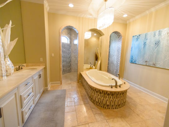 The master bath is a soothing, spa-like retreat.
