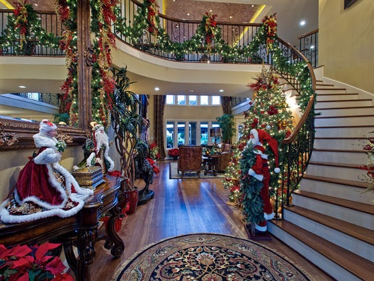 The garland lined winding staircase rises above the