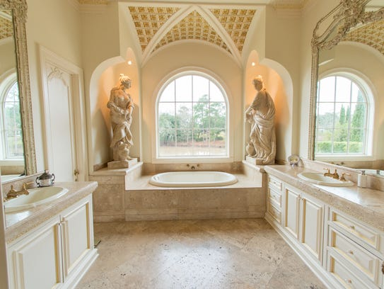 The master bath has views of the Vermilion River.