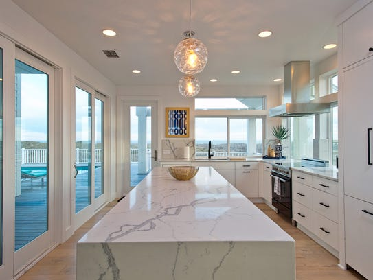 The incredible glass surrounded kitchen is strategically