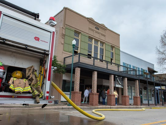 Fire damaged Greenwood Shoes on Jefferson Street Sunday.