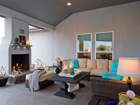 The outdoor patio with its own fireplace is the perfect
