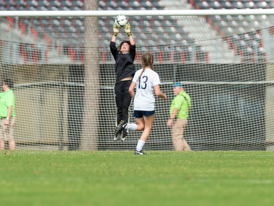 ESA keeper Ella Frantzen goes high to tip the ball over the crossbar for a save during the Lady Falcons' 2-0 loss to Newman in the Division IV state soccer finals Friday.