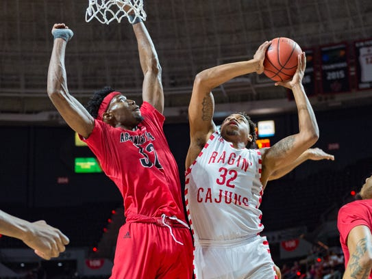 Bryce Washington (32) works under the basket during UL's win over Arkansas State last week.