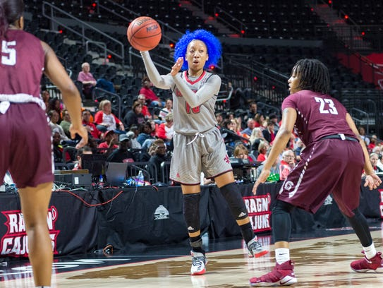 UL's Troi Swain makes a pass down low during the Cajuns' overtime loss to Little Rock on Saturday.