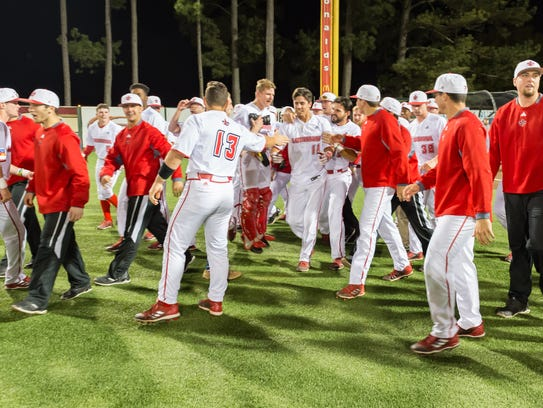 UL celebrates its 4-3 win over LSU after Jonathan Windham's walk-off, bases-loaded single in the 10th inning Wednesday night.