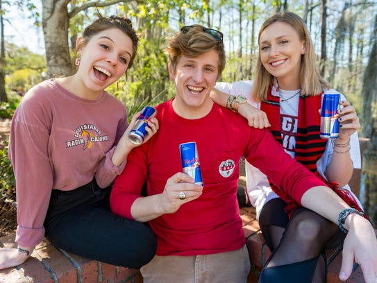 "Brandii Champagne, Sam Riehl and Emily Daigle are three UL Lafayette students competing in the Red Bull ""Can You Make It?"" challenge to travel across Europe using only cans of the energy drink as currency."