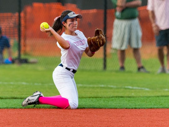 Katelyn Norse at second base throws the runner out