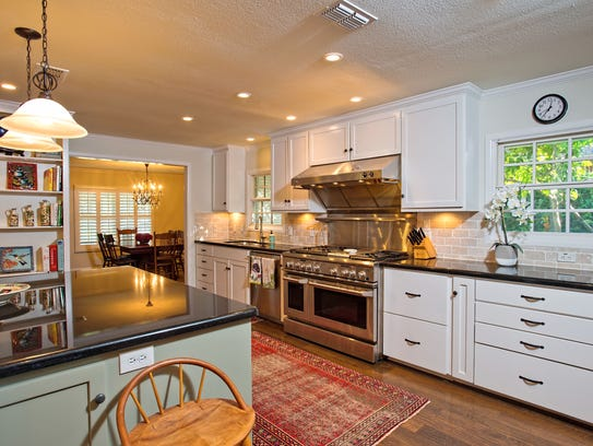 The amazing kitchen has it all with giant island/breakfast