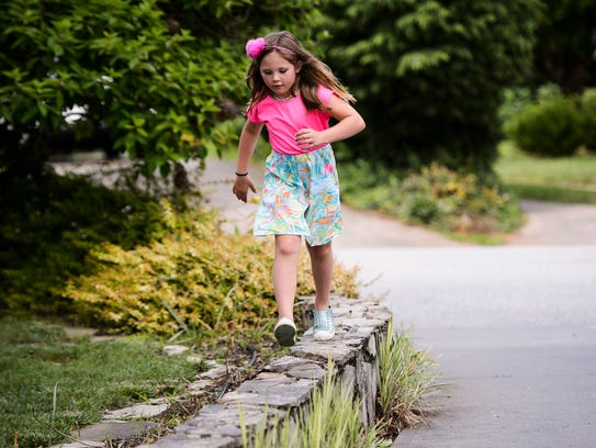 Madison Barber, 7, plays at her home on Thursday, May