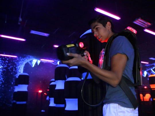 Fernando Martinez, 14, plays laser tag Wednesday with