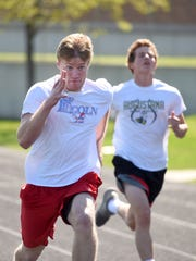 Lincoln's Collin Brison sprints during practice at