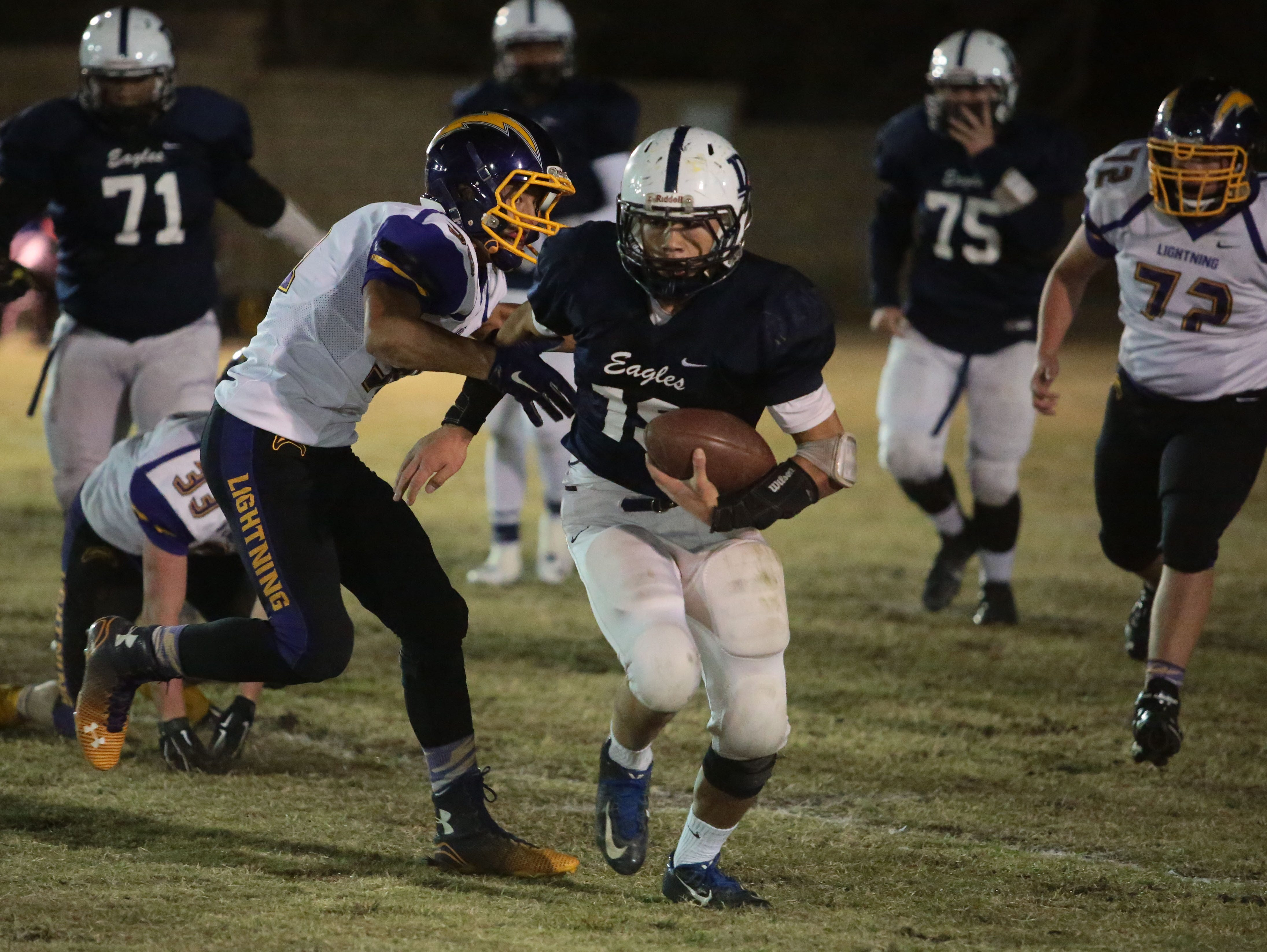 Desert Chapel's Ethan Skarmas carries the ball against Joshua Springs during the CIF-SS Div. II 8-man football championship in Palm Springs on Saturday.