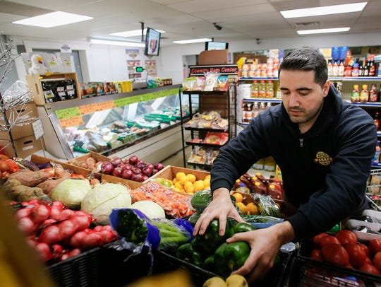 1910 Food Market owner Revan Herfy, 30, drives to Lansing