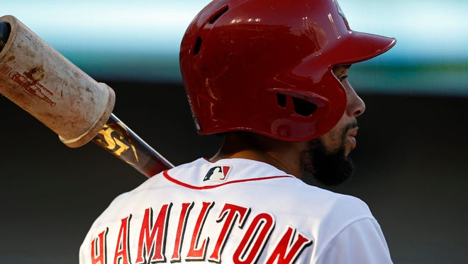 Cincinnati Reds center fielder Billy Hamilton (6) warms up in the on deck circle in the bottom of the second inning of the MLB National League game between the Cincinnati Reds and the Arizona Diamondbacks at Great American Ball Park in downtown Cincinnati on Wednesday, July 19, 2017.
