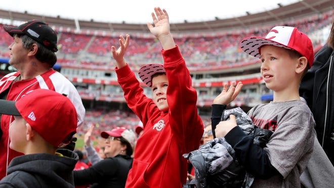 Aiden Stitsinger, 10, left, and his cousin Blake Parker 8, both of Hamilton, enjoy the Reds - Pirates game during a Kids Game at the Great American Ballpark.