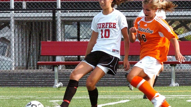 Girls high school soccer players from Durfee and Taunton High compete for a ball in this 2009 file photo.