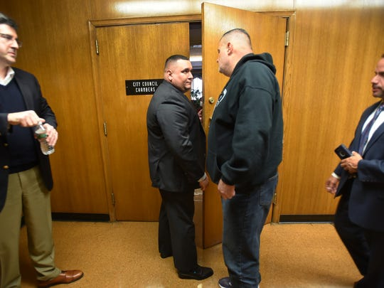 Officer Victor Vasquez, second from left, is seen during a disciplinary hearing for the five suspended Hackensack police officers at City Hall in Hackensack on Dec. 6, 2017.