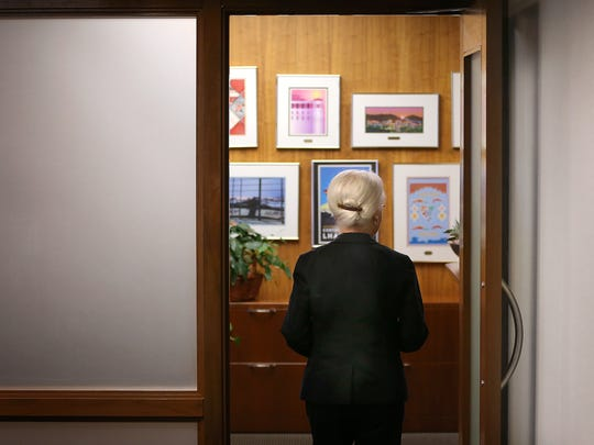 UTEP President Diana Natalicio walks into her office Tuesday after discussing her decision to retire as soon as her successor is found. Natalicio has served as UTEP's president for 30 years.