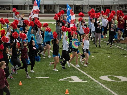 Ruidoso cheerleaders, along with cheerleaders from