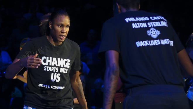 Minnesota Lynx players wore T-shirts in support of Black Lives Matter and Dallas police, plus the two African-American men who were killed last week