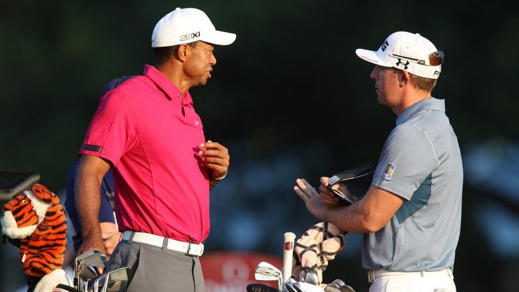 Tiger Woods and Hunter Mahan chat Wednesday morning.
