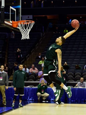 Michigan State guard Denzel Valentine dunks during practice at Time Warner Cable Arena.