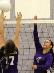 Mescalero's Alarah Kazhe-Kirgan, right, spikes a ball over Gateway Christian's Kaylee Stephens on Thursday night at Mescalero Apache School.