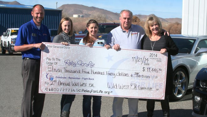 Wild West Chevrolet on Friday presented $11,440.26 it raised during its second annual Wild West 5K run/walk on Nov. 15 to the American Cancer Society/Relay for Life. Presenting and accepting the donation are, from left, Shane Martin, WWC sales consultant; Jennifer Campbell, senior director, community engagement, ACS; Ashlee Lindberg, WWC finance director; Don Lindberg, owner; and Patti Davidson, senior representative, community engagement, ACS.