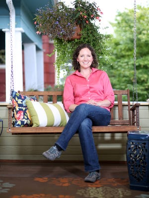 Katie Abbott of Portland, Ore., is part of a new trend of single women purchasing homes. Her 1906 craftsman features a wrap-around porch complete with swing.