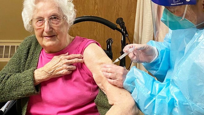 A Maple Lawn resident receives the COVID-19 vaccine. [Photo provided