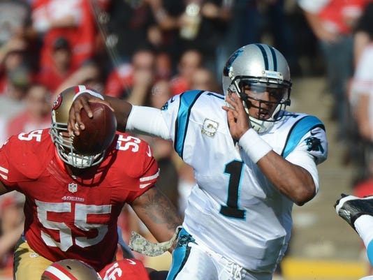 Carolina quarterback Cam Newton (1) runs past San Francisco 49ers defensive  end Ray McDonald (91) during the Panthers  10-9 victory Nov. 10. 64051bbf6