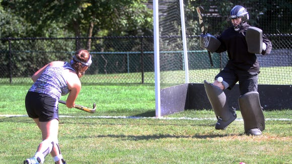Sophie Berkowitz of Horace Greeley shoots on goalie Willa Khun during field hockey practice Wednesday.