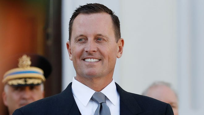 In this file photo taken on May 8, 2018 then newly accredited U.S. Ambassador to Germany Richard Allen Grenell stands in front of a military honor guard during an accreditation ceremony for new Ambassadors in Berlin.