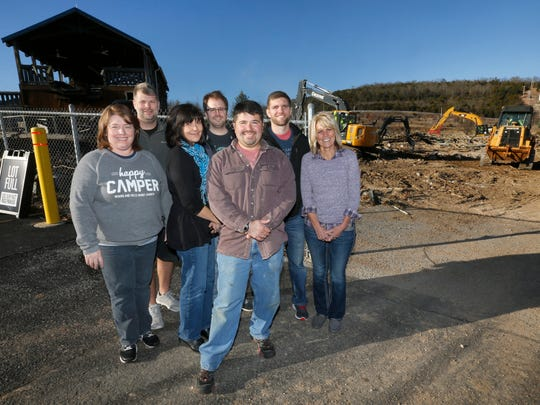 From left, Stephanie Watson, Andy Watson, Donna Seiler, Corey Mitchell, David Everson, Mickey Pitman and Denise Bevins, all of Woodland Hills Family Church stand in front of what remains of the Ozark Wildcat rollercoaster which once stood in front of the Branson church.