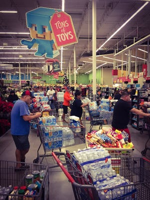 The line at HEB stretches all the way to the produce section. HEB mobilizes quickly in emergencies and restocks quickly