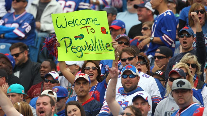 Bills fans show their loyalty to the Bills and new owner Terry Pegula.