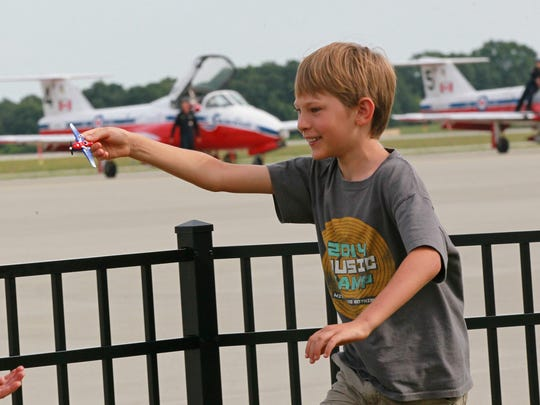 Nathan Sorenson of Senoia, Georgia pretends to fly a plane near The Royal Canadian Snowbirds who just landed at the Anderson Regional Airport. Nathan's father Mark said he was born in a airplane hangar and loves planes.