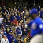 Chicago Cubs fans react after Chicago Cubs' Fernando Rodney got out during the eighth inning of a baseball game against the Milwaukee Brewers, Saturday, Oct. 3, 2015, in Milwaukee. (AP Photo/Darren Hauck) ORG XMIT: WIDH108