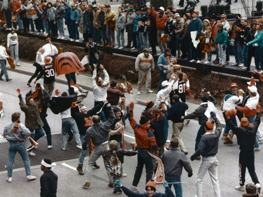 Jubilant Bengals fans dance along Fifth Street near Fountain Square following the team's playoff victory over Buffalo in the AFC Championship game.