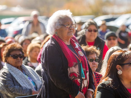 Family members of Navajo Code Talkers stand to be recognized during an unveiling ceremony for a monument dedicated to the Navajo Code Talkers on Friday, Nov. 10, 2017 at the San Juan County Administration Offices in Aztec.