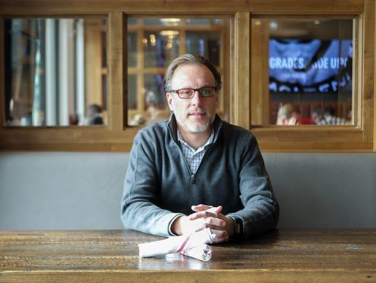 Taste of Belgium owner, Jean-Francois Flechet, sits