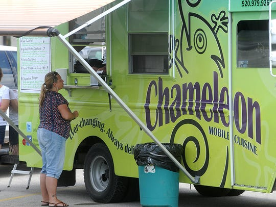 Lana Tank orders food from the Chameleon food truck