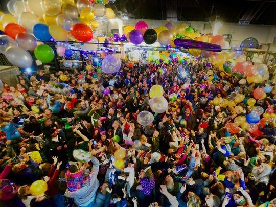 Balloons are released to kids and their parents at York's Central Market on a previous New Year's Eve. The balloon drop is scheduled for 8 p.m. Saturday.