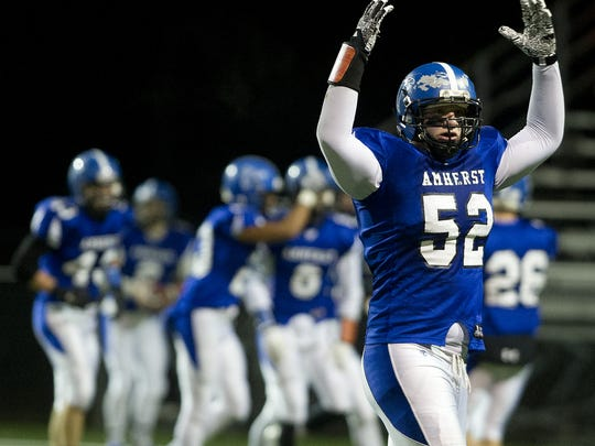 Amherst senior lineman Tyler Biadasz signed a letter-of-intent to play football at the University of Wisconsin on Wednesday. He will be joined by Garrett Groshek, who accepted a walk-on offer from the Badgers, while Ben Gutschow signed with Division II St. Cloud State.